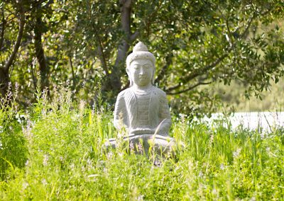 This Buddha statue greets you as you near the bottom of the hill by the creek.