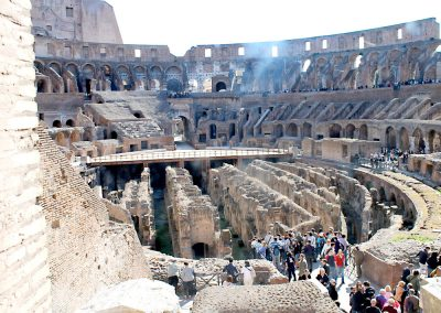 Looking down on the Colosseum floor and tunnels below from a window above.