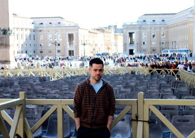 St. Peter's Square spreds out behind him