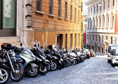 A common scene in Rome. Streets lined with scooters.