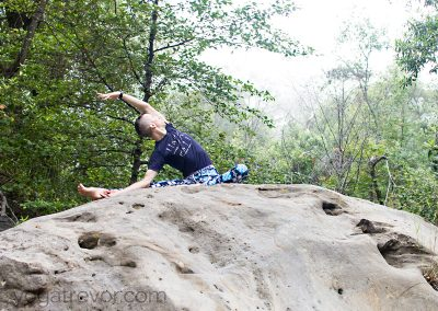 Revolved Janu Sirsasana on a big rock.